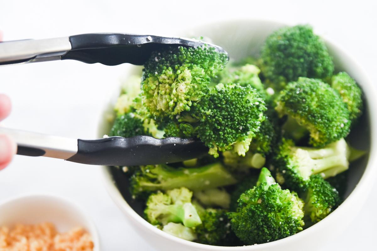broccoli in tongs