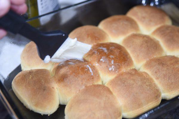 brushing butter on rolls